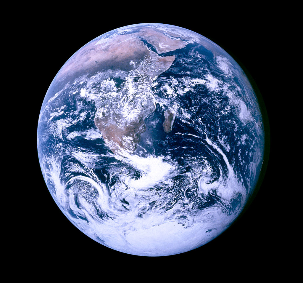 Image shows a photograph of earth taken from space.