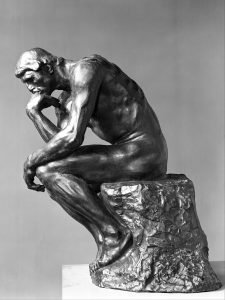 The Thinker (French: Le Penseur) is a bronze sculpture by Auguste Rodin, usually placed on a stone pedestal. The work shows a nude male figure of over life-size sitting on a rock with his chin resting on one hand as though deep in thought, often used as an image to represent philosophy.
