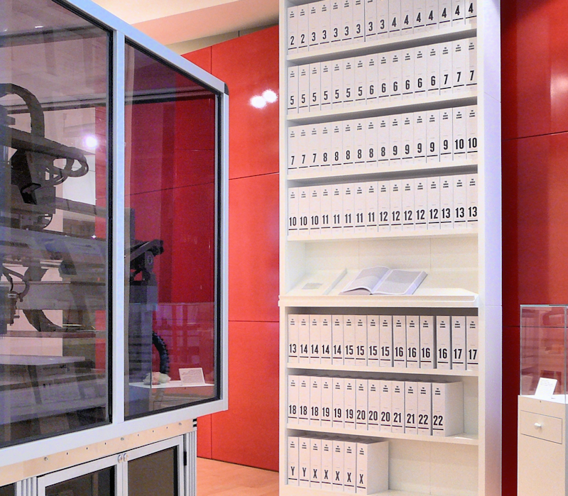 """The first printout of the Human Genome presented as a series of books, displayed in the """"Medicine Now"""" room at the Wellcome Collection, London."""